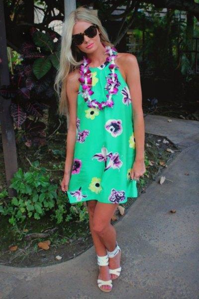 green halter in midi Hawaiian style dress with white open toe heels
