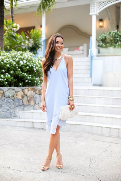 Light blue midi shift dress with a deep V-neck and white heels with open toes