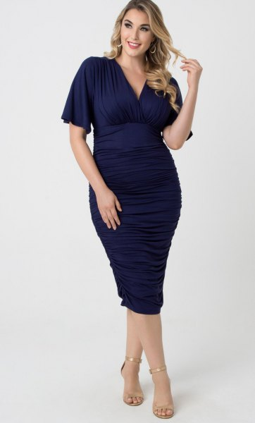 deep blue, form-fitting midi dress with V-neck and open toe heels