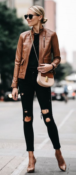 brown leather motorcycle jacket with torn black skinny jeans with cuffs