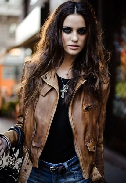 brown leather motorcycle jacket with black t-shirt and blue jeans