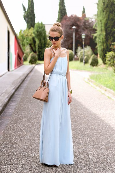 light blue chiffon maxi dress with ruffled waist and brown shoulder bag