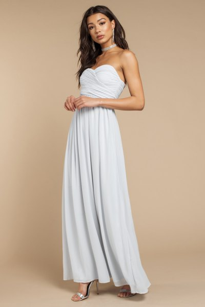 silver choker with light blue maxi dress with a heart-shaped neckline