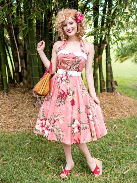 pink halter fit with floral print and flared midi dress
