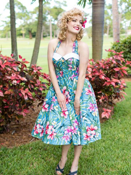 teal, blue and white halter outfit in Hawaiian style and flared midi dress