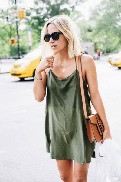 Mini green silk shift dress with brown leather shoulder bag