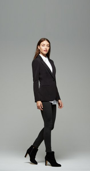 white shirt with buttons, black blazer and ankle boots with heels