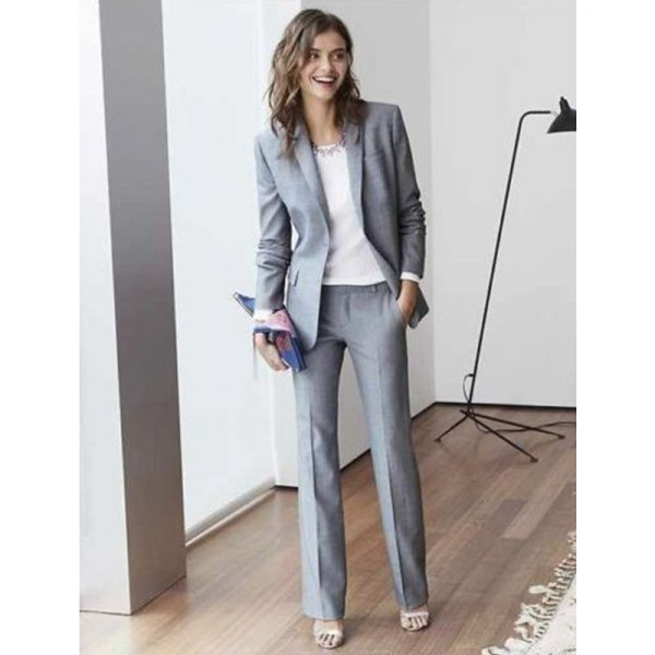 gray suit with white chiffon blouse and statement chain