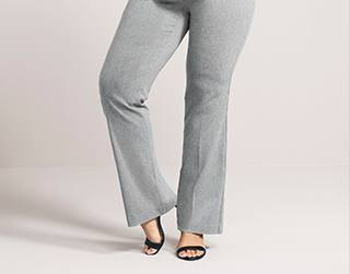 gray dress pants with black ankle straps and open toe heels