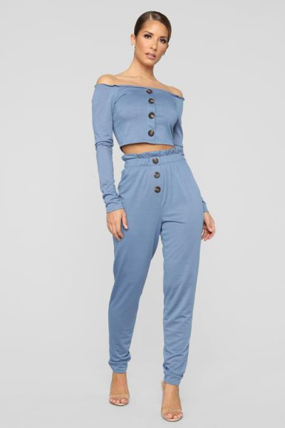 strapless long-sleeved crop top with gray elastic waist trousers
