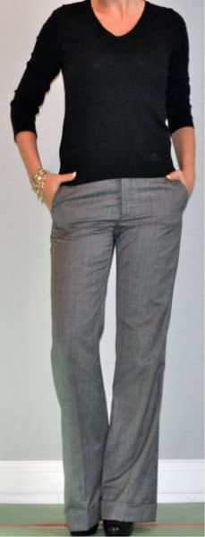 black v-neck sweater and gray dress pants with wide legs
