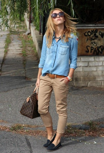 Light blue chambray shirt with buttons and green khaki pants