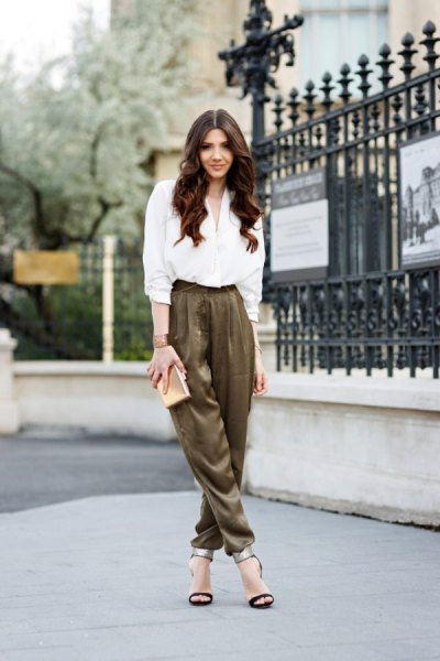 white shirt with buttons and green khaki dress pants with elastic waist
