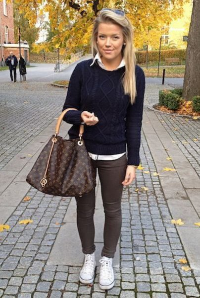 black knit sweater with white shirt and gray skinny pants
