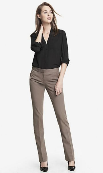 black shirt with buttons and gray, slim-fitting suit pants