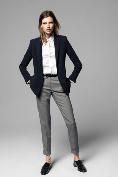 black blazer with gray cuff pants and oxford shoes