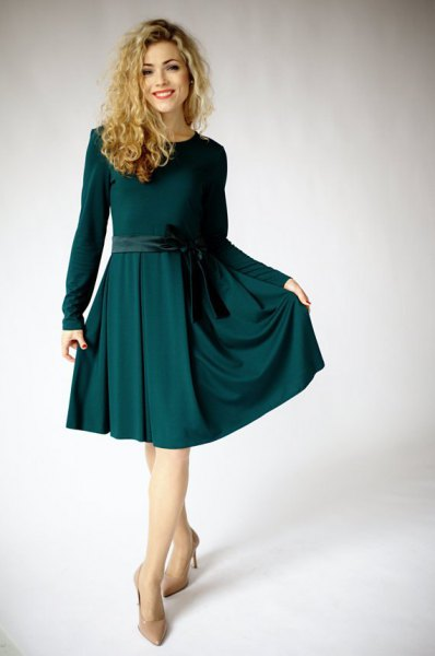 Long sleeve dark green cut and flared midi dress with light pink heels