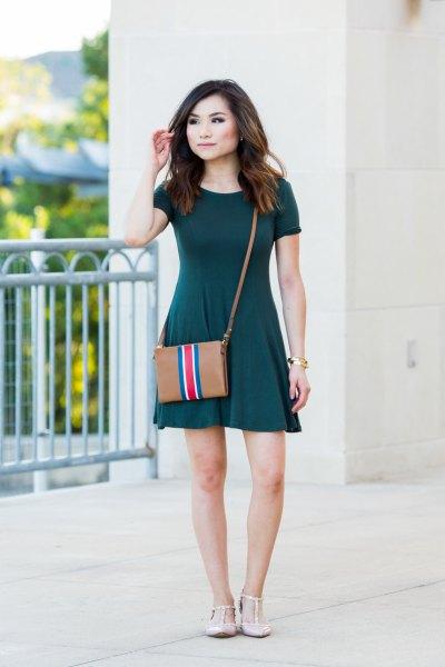 Short sleeve mini dark green skater dress with brown leather shoulder bag