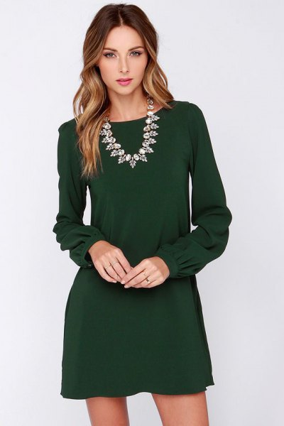 Long sleeve mini dress with a silver statement chain