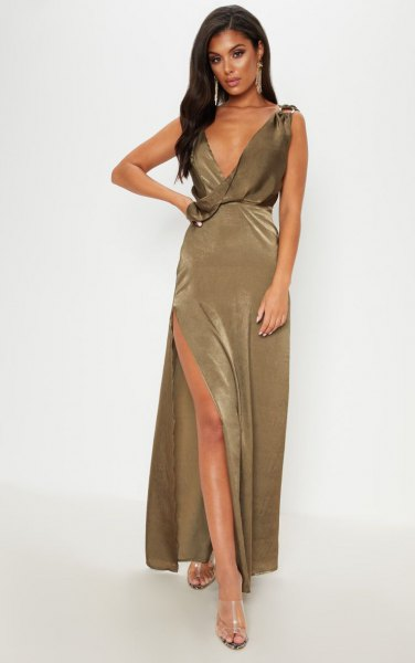 deeply slit khaki maxi dress with deep V-neck and silver, open toe heels