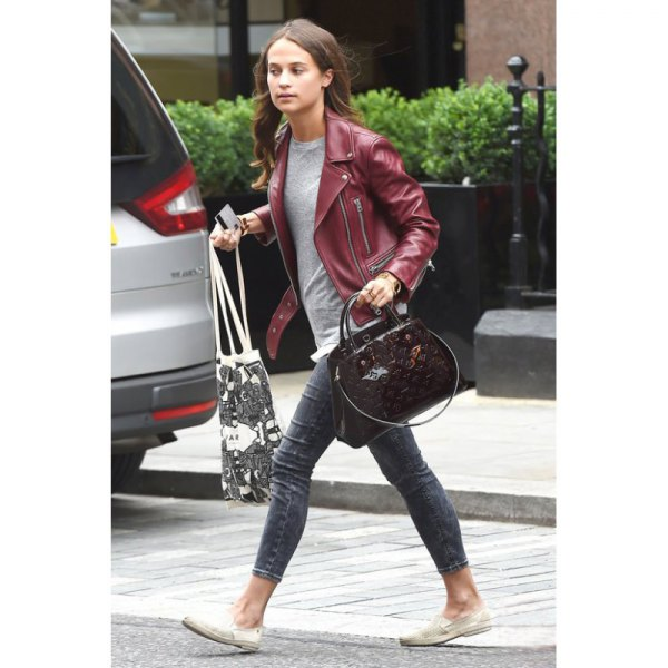 Maroon leather jacket with gray t-shirt and skinny jeans with cuffs