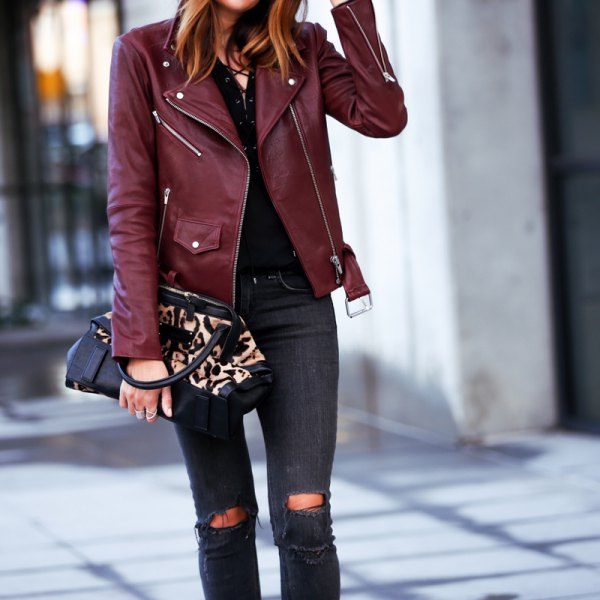 Maroon leather jacket with black skinny jeans