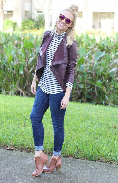 Maroon leather jacket with black and white striped t-shirt with stand-up collar