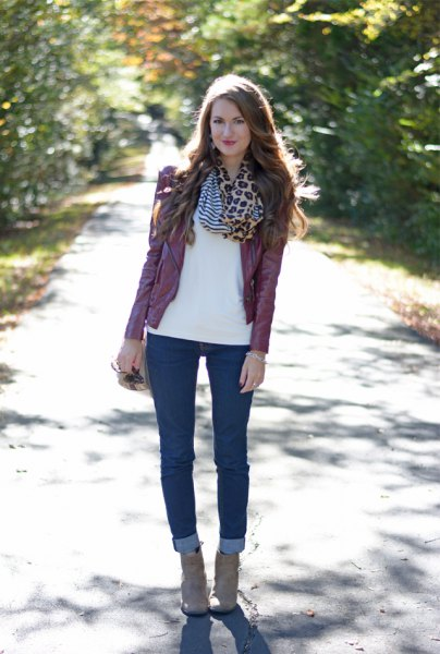 white chiffon blouse with infinity scarf with leopard print and dark jeans