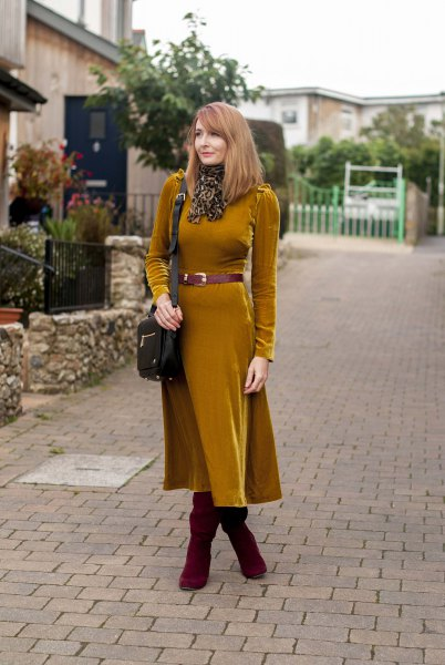 Orange long sleeve velvet midi dress with belt and boots
