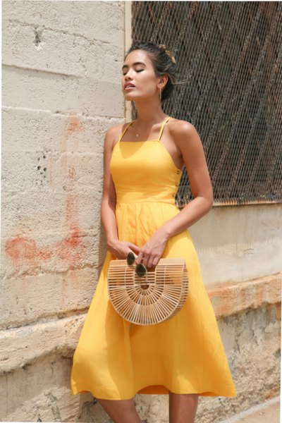 light yellow fit and flared halter chiffon dress