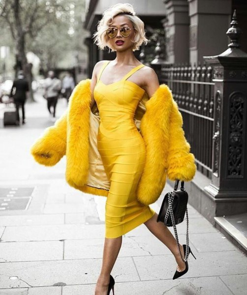 yellow sleeveless, low-cut midi bandage dress with faux fur coat