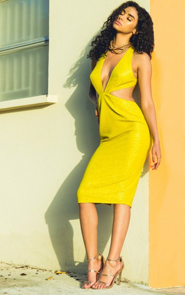 yellow midi dress with deep V-neck and straps and open toe heels