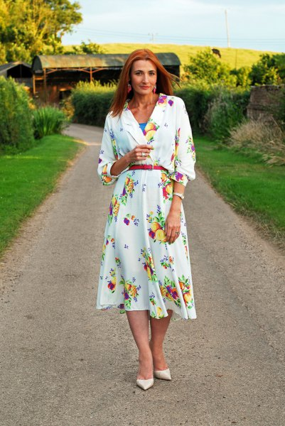 white long-sleeved midi dress with floral print and belt