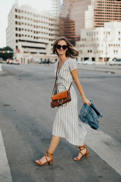 gray and white midi dress with gathered waist and red heels