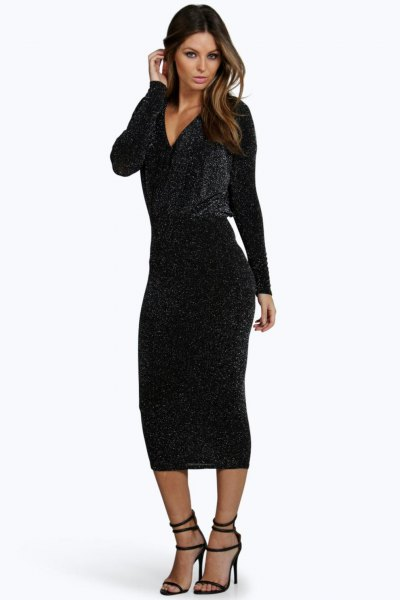 black, low-sleeved, figure-hugging midi dress with deep V-neck and open toe heels