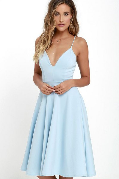 Light blue dress with a deep v-neck and flared dress