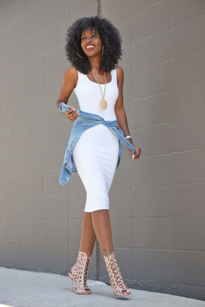 white, form-fitting midi dress with blue denim jacket and cut-out boots with ankle heel