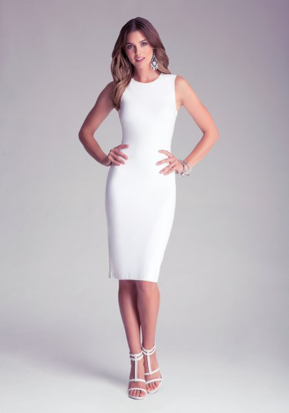 white, form-fitting midi dress with open toe heels