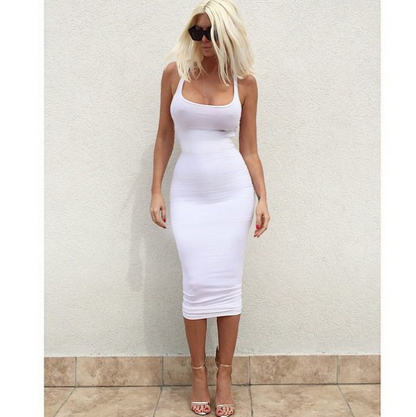 body-hugging midi dress with a low square neckline and light pink open toe heels