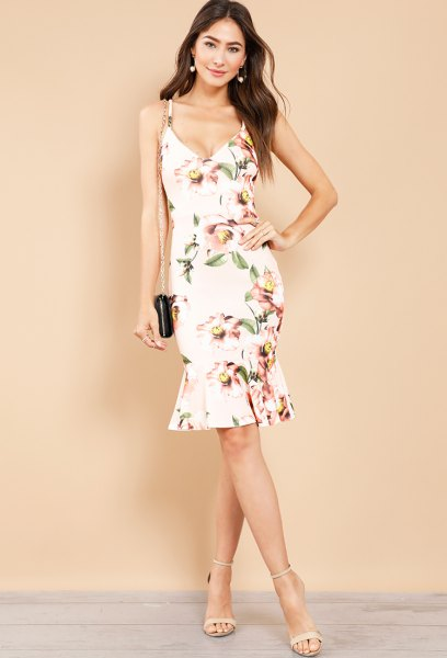 white midi dress with floral pattern and light pink open toe heels