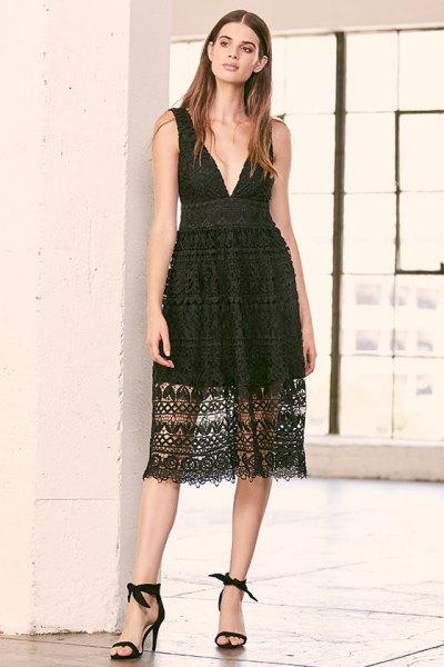 black, semi-transparent midi dress with deep V-neck and open toe heels