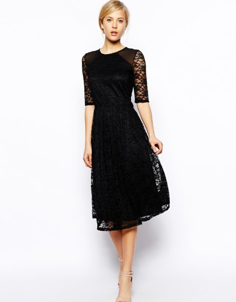 black dress with half sleeves and flared lace dress