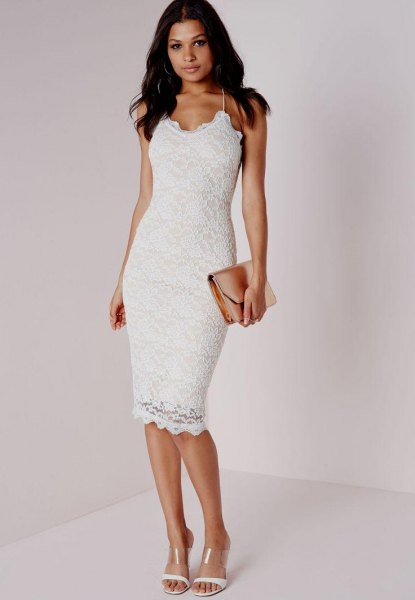 white dress with spaghetti strap and figure-hugging hem with clutch pocket
