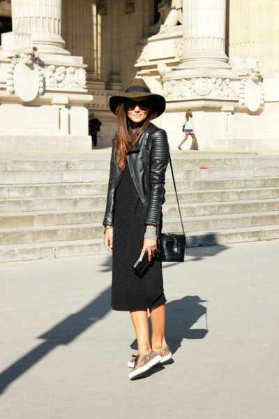 black leather jacket with floppy hat and black shift midi dress with sleeves
