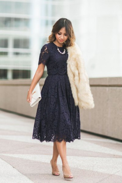 black short-sleeved lace fit and flare midi dress with white faux fur coat
