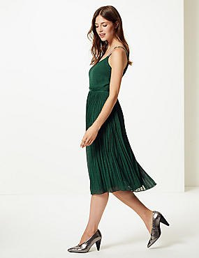green pleated midi dress with silver heels