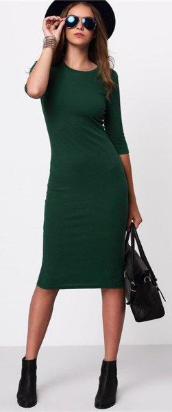 black felt hat with green midi dress with three-quarter sleeves