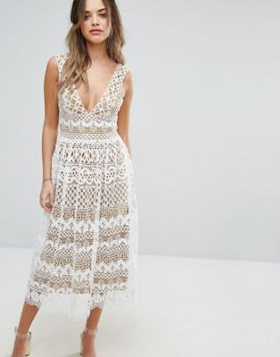 white midi dress and flared lace dress with deep V-neck