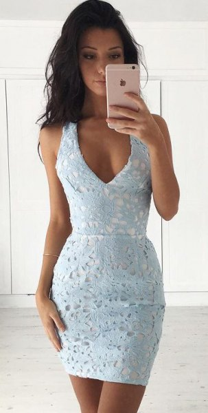 super light blue-green, deep, form-fitting mini dress with V-neck