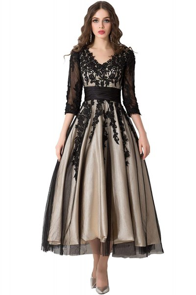 black, semi-transparent dress with three-quarter sleeves and floor-length dress with a lace V-neck